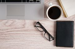 Free Top View Of Laptop And Notepad With Glasses And Pocketbook On Wood Desktop And Cup Of Coffee. Stock Image - 111443731