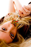 Top View Of Laying Sensuous Woman Licking Candy Stock Photography