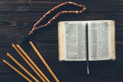 Free Top View Of Open Holy Bible With Rosary And Candles Stock Photo - 119797120