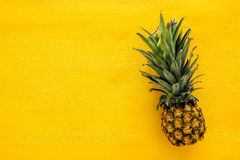 Top View Of Pineapple On Colorful Table. Summer And Tropical Concept Stock Images