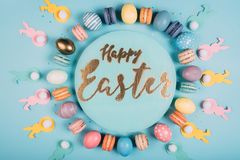 Free Top View Of Round Board With Happy Easter Lettering And Colorful Easter Decor Around Royalty Free Stock Image - 120908636