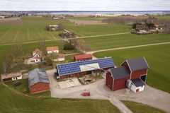 Free Top View Of Rural Landscape On Sunny Spring Day. Farm With Solar Photo Voltaic Panels System On Wooden Building, Barn Or House Stock Image - 150464821