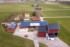 Free Top View Of Rural Landscape On Sunny Spring Day. Farm With Solar Photo Voltaic Panels System On Wooden Building, Barn Or House Royalty Free Stock Photo - 154400855