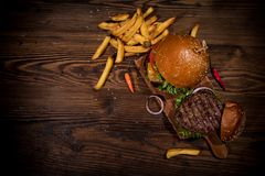 Free Top View Of Tasty Burgers On Wooden Table. Royalty Free Stock Photography - 130128387