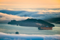 Top View Of The Coast, Covered By Fog. Royalty Free Stock Images