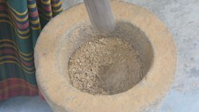 Free Top View Of Unrecognizable Indian Man Grinding Ingredients In A Stone Mortar And Pestle For Preparation Of Seasonings Stock Photo - 114697640