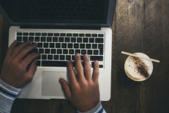 Free Top View Of Workstation With Modern Technology Laptop Computer And Hands To Use It And Write - Coffee Or Cappuccino Drink At Its Royalty Free Stock Photography - 159319657