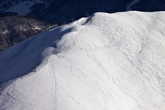 Top view on off piste slope with snowboarders and skiers in even Royalty Free Stock Photo