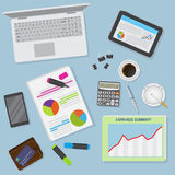 Top view of office desk background including laptop, digital devices, financial and business objects. Stock Image