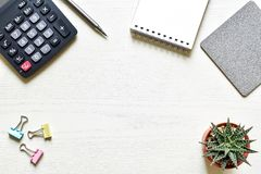 Top view office desk. Create new ideas with copy space or input text have paper sheet, pencil, calculator, clip, cactus is elements royalty free stock photos