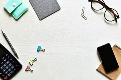 Top view office desk. Create new ideas with copy space or input text have paper sheet, pencil, mobile, calculator, clip, glasses is elements royalty free stock images