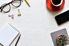 Top view office desk. Create new ideas with copy space or input text have paper sheet, pencil, mobile, clip, glasses, black coffee, cactus is elements royalty free stock images