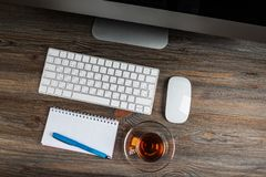 Top view office desk. With cup of tea royalty free stock image