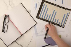 Top view of office desk with graphs. And paper stock photos
