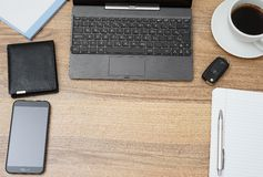 Top view of office desk with laptop and accessories.  royalty free stock images