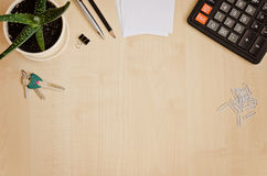 Top view office desk with paper for notes, calculator, indoor pl Stock Photos