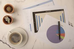 Top view of office desk with paperwork. Top view of office desk with graphs and paper royalty free stock images