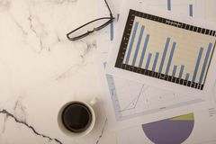 Top view of office desk with paperwork. Top view of office desk with graphs and paper royalty free stock image