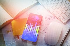 Desk with forex chart on phone Stock Photos
