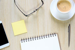 Top view of office desk table with computer, smartphone, glasses Royalty Free Stock Image