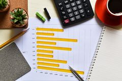Top view office desk. Blank white book and pencil for notes business marketing plan have calculator, black coffee, cactus, paper clip is a elements royalty free stock photo