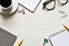 Top view office desk. Create new ideas with copy space or text have black coffee, paper sheet, pencil, glasses, clip is elements royalty free stock photos