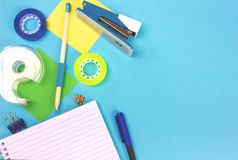 Top view of office desktop with school supplies. stock photography