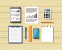 Top View of Office Objects on Wooden Desk Stock Photo