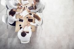 Top view in office while people having a meeting royalty free stock photos