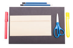Top view of office supplies and envelop on black paper Royalty Free Stock Photography