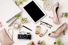 Top view office table desk. Workspace with tablet , photo camera and female fashion accessories on white background. Flat lay, top view office table desk Royalty Free Stock Images