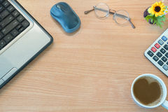 Top View Of Office Wooden Desk With Notebook, Mouse, Glasses, Fl Stock Photo