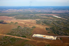 Top view oil rig at an oil field. Aerial view of oil rig at an oil field in Western Siberia in the autumn Stock Photography