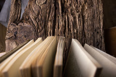 Top view of old book stack over old grunge natural wooden shabby Royalty Free Stock Images
