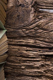 Top view of old book stack over old grunge natural wooden shabby. Table Stock Images