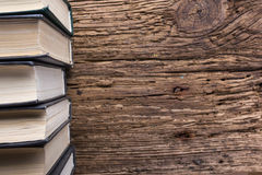 Top view of old book stack over old grunge natural wooden shabby Royalty Free Stock Photography