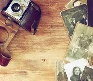 Top view of old camera, antique photographs. Stock Photo