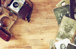 Top view of old camera, antique photographs Royalty Free Stock Photos
