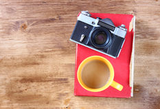 Top view of old camera cup of coffee Stock Images
