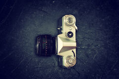 Top view of old camera over blackboard Royalty Free Stock Image