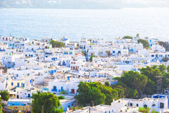 Top view of the old city and the sea on the island of Mykonos, Greece. A lot of white houses against the blue sky Stock Image