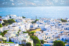 Top view of the old city and the sea on the island of Mykonos, Greece. A lot of white houses against the blue sky Stock Images