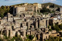 Tuff city of Sorano. Top view of the old  famous tuff city of Sorano, province of Siena. Tuscany, Italy Royalty Free Stock Photos