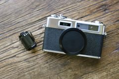 Top View of Old Film Camera with Lens Cap and Roll of Film royalty free stock photography
