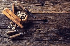 Top of view old planer and other vintage carpenter tools in a carpentry workshop.  stock photography
