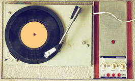 Top view of old record player, image is retro filtered. Royalty Free Stock Images