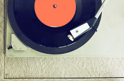Top view of old record player, image is retro filtered Royalty Free Stock Image