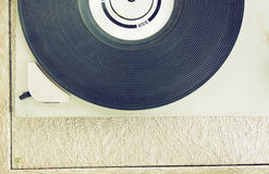 Top view of old record player, image is retro filtered. Stock Photography