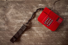 Top view of old red telephone. Stock Photo