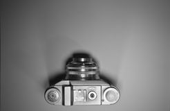 Top view of old retro vintage camera isolated and highlighted in black and white royalty free stock images